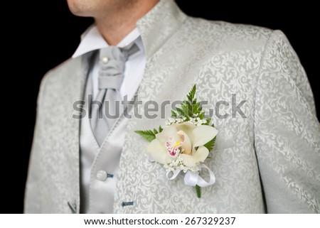 boutonniere in tuxedo lapel - stock photo