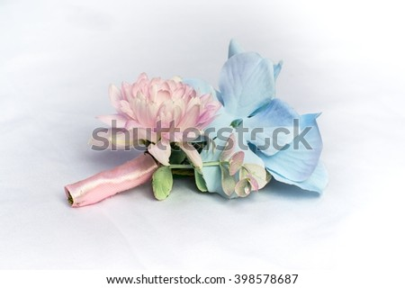 Boutonniere of the groom, decoration for wedding, on white background - stock photo
