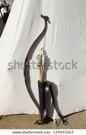 bow and arrows medieval soldier resting on a white tent - stock photo