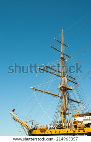 Bow and Mast of sailing ship against a blue sky background - stock photo