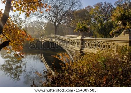 Bow bridge in autumn Central Park, New York City - stock photo