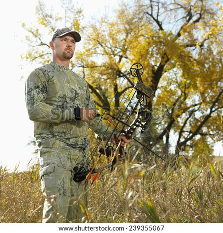 Bow Hunter with Compound Bow - stock photo