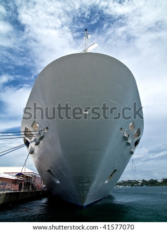 Bow of a cruise ship in dock - stock photo