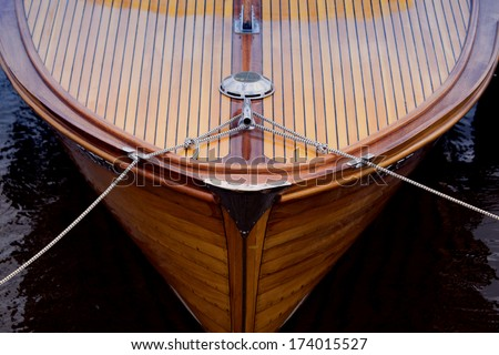 Bow of a wooden boat - stock photo