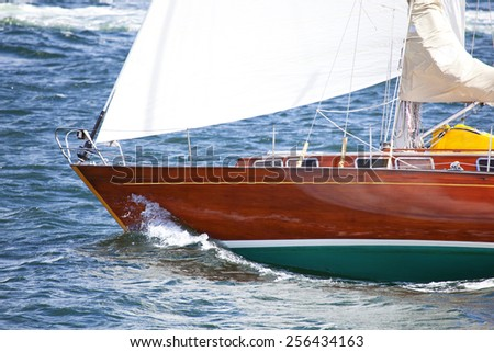 Bow of a wooden sailboat - stock photo