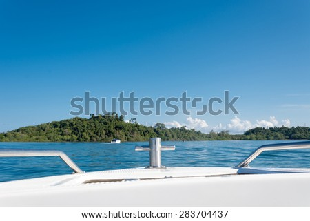 Bow of speed boat heading in the sea - stock photo