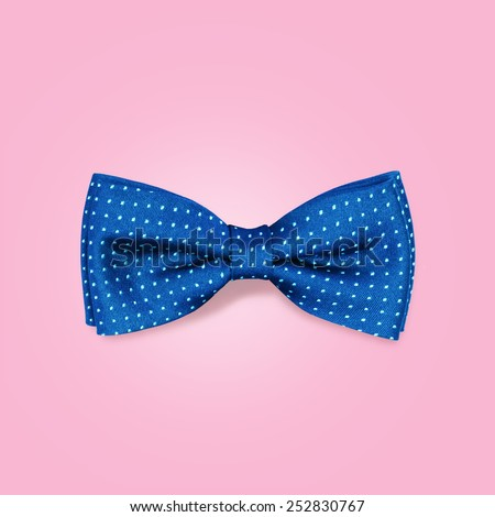 bow-tie  on a pink background - stock photo