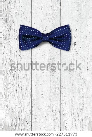 bow tie on wooden texture - stock photo
