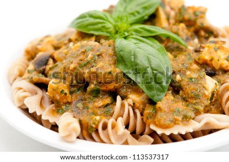 bow tie pasta in a creamy basil pesto sauce with diced chicken breast - stock photo