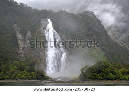 Bowen Falls, Milford Sound, South Island, New Zealand - stock photo