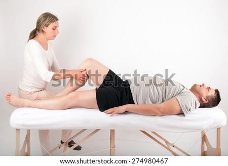 Bowen therapy - massage treatment of a man - stock photo