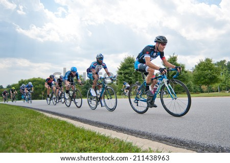 BOWIE, MARYLAND - AUGUST 17: Cyclists compete in the elite men's race in the Dawg Days of Summer Circuit Race on August 17, 2014 in Bowie, Maryland - stock photo