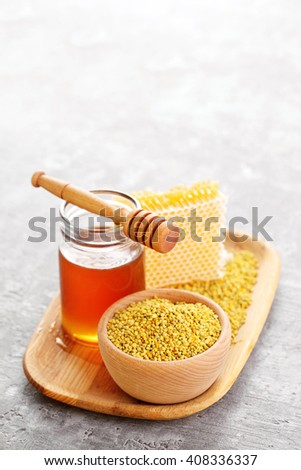 bowl full of bee pollen with honey comb - sweet food - stock photo