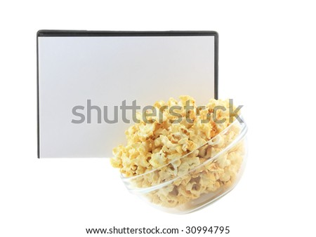 Bowl full of caramel popcorn with  balnk DVD cover. Isolated - stock photo