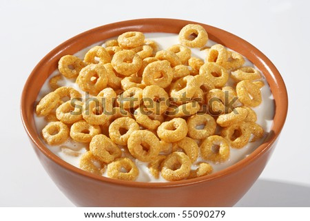 Bowl full of honey corn flakes rings - breakfast - stock photo