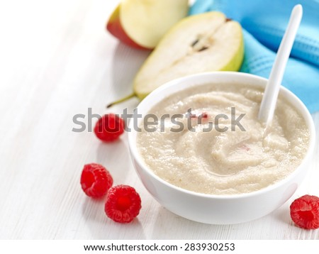 bowl of baby food, healthy breakfast porridge - stock photo