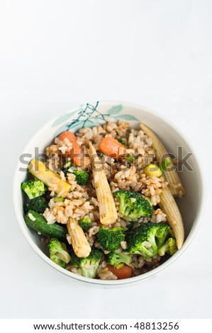 Bowl of brown rice and vegetables - stock photo