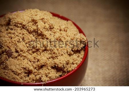 Bowl of brown sugar - stock photo
