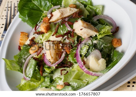 bowl of caesar salad placed - stock photo