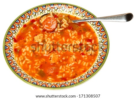 Bowl of Cajun Gumbo Soup in Bowl with silver spoon. - stock photo