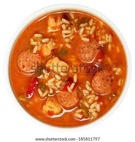 Bowl of Cajun Spicy Chicken and Sausage Gumbo Soup Over White - stock photo