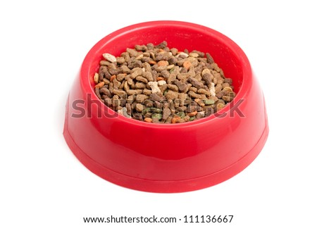 Bowl of cat food isolated on white - stock photo