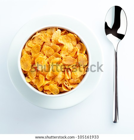 Bowl of cereal and spoon waiting for milk set on the table for a nutritious breakfast - stock photo