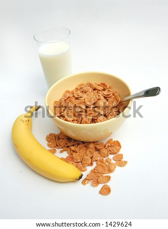 Bowl Of Cereal, Glass of Milk And Banana, Part Of Your Balanced Breakfast - stock photo