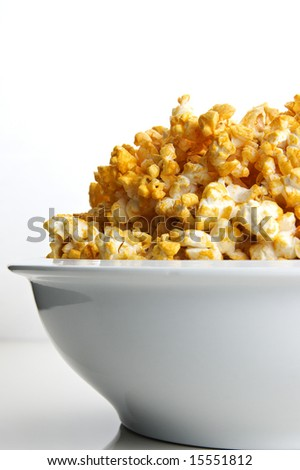 Bowl of cheese flavored popcorn with space for copy - stock photo