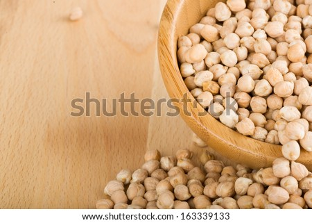 Bowl of chickpea on wooden background - stock photo
