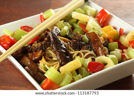 Bowl of chinese meal with noodles and veggies - stock photo