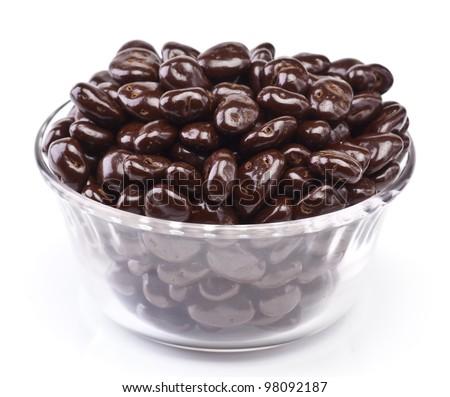 bowl of chocolate covered raisins, isolated on white - stock photo