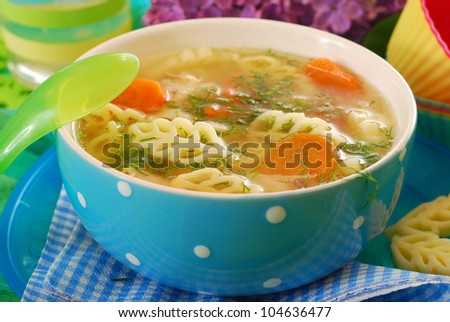 bowl of clear chicken soup with ear shape noodle for child - stock photo