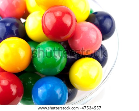 Bowl of colorful gumballs on white - stock photo