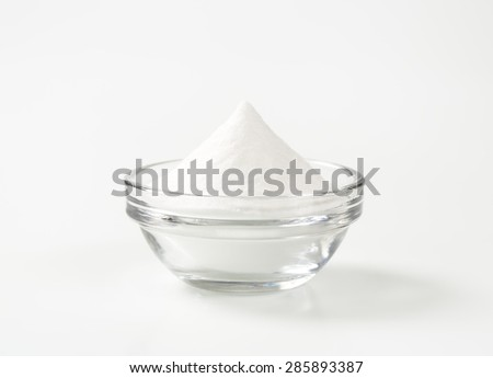 bowl of cooking soda on white background - stock photo