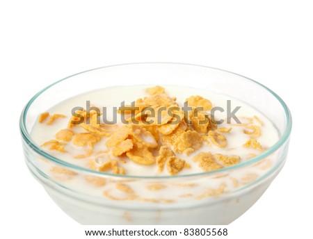 Bowl of cornflakes with milk on white background - stock photo