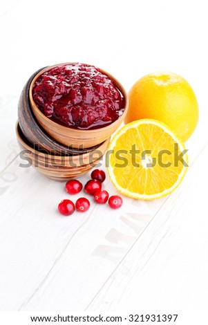 bowl of cranberry sauce - goods in jar - stock photo