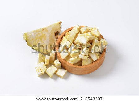 bowl of cubed celery on white background - stock photo