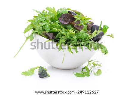 bowl of fresh green salad, close-up, isolated on white - stock photo