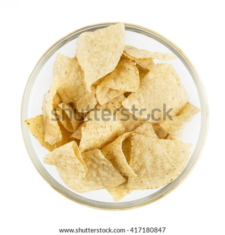 Bowl of fresh tortilla chips isolated on white and viewed from above. - stock photo