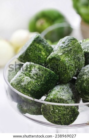 Bowl of frozen spinach - stock photo