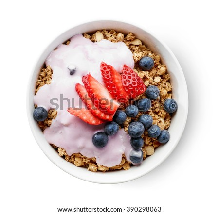 bowl of granola with yogurt and berries isolated on white background, top view - stock photo