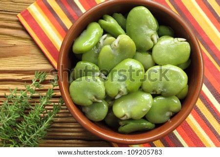 Bowl of green boiled broad beans - stock photo