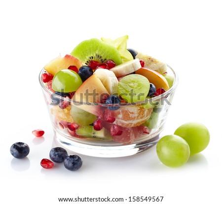 Bowl of healthy fresh fruit salad on white background - stock photo
