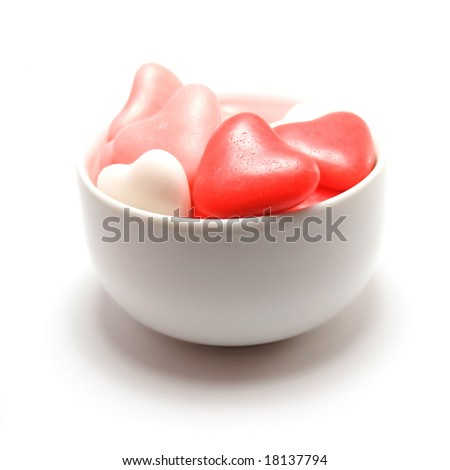 Bowl of heart shaped candy isolated on a white background - stock photo