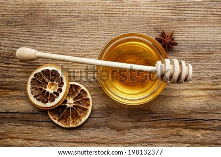 Bowl of honey on wooden table. Symbol of healthy living and natural medicine. Aromatic and tasty. Top view. - stock photo