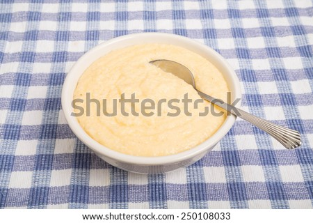 Bowl of hot, creamy, buttery, cheese grits - stock photo