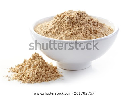 bowl of maca powder isolated on white - stock photo