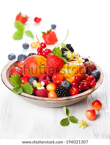 Bowl of mixed berries on the table - stock photo