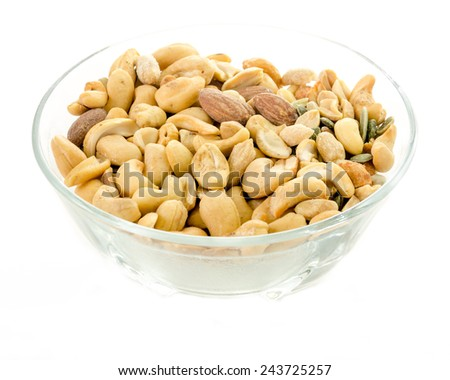 Bowl of mixed nuts - salted peanuts, almonds, piquant peanut, sunflower and pumpkin on a white background - stock photo